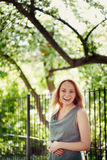 Beautiful laughing young woman in the park. Summer, freedo Stock Photo