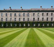 Lawn with pattern in front of the Trinity College stock images