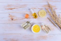 Beautiful layout of cosmetic oils on a wooden background. Natural cosmetics for face and body. With citrus notes royalty free stock images