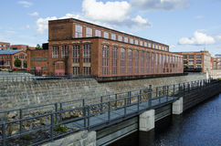 Beautiful םld factory's buildings region by the river, Finland Royalty Free Stock Image