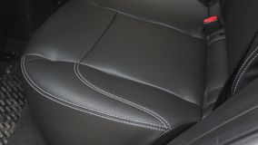 Beautiful leather car interior design. luxury leather seats in the car. artificial leather rear seats in the car. Black. Leather seat covers in car stock video