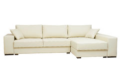 Beautiful leather sofa beige color on a white Stock Photos