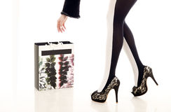 Beautiful leg and shopping bag Royalty Free Stock Photos