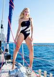 Beautiful leggy blonde on yacht Royalty Free Stock Photography