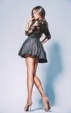 Beautiful leggy brunette in the studio Royalty Free Stock Photos