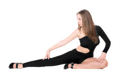 Beautiful leggy girl. Sitting in a black tight-fitting body suit dance Stock Image
