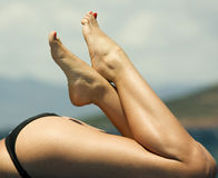 Beautiful legs. With a black  bikini Royalty Free Stock Photos