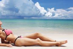 Beautiful legs on the beach Stock Photos