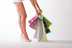 Beautiful legs in beige shoes. Royalty Free Stock Image