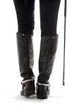 Beautiful legs in black leather horseman boots with riding-crop. Over white Stock Photo