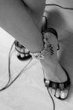 Beautiful legs with bracelet Stock Images