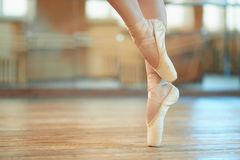 Beautiful legs of dancer in pointe. Beautiful legs of a dancer in pointe royalty free stock photography