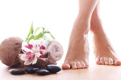 Beautiful legs and different spa items Stock Images