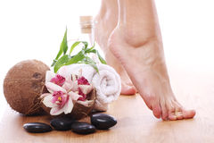 Beautiful legs and different spa items Stock Photography