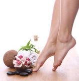 Beautiful legs and different spa items Royalty Free Stock Photo