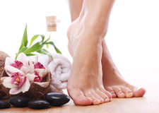 Beautiful legs and different spa items Royalty Free Stock Photos