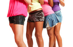 Beautiful legs of four models Royalty Free Stock Images