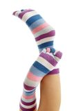 Beautiful legs in funny socks. Over white Stock Images