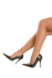 Beautiful legs on high heels. Isolated on a white background Royalty Free Stock Image