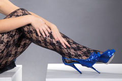 Beautiful legs with high heels and hands Stock Image