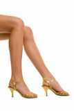 Beautiful legs on high heels isolated on a white. Background Stock Photo
