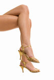 Beautiful legs on high heels isolated on a white. Background Stock Images