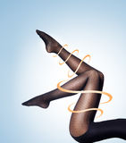 Beautiful legs in nice pantyhose on a light blue background Stock Images