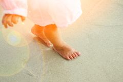 Beautiful Legs On The Sand By The Greek Sea Royalty Free Stock Photos