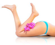 Beautiful legs and orchids stock photo