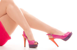 Beautiful legs in red shoes on white background Royalty Free Stock Images