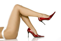 Beautiful legs in red shoes Royalty Free Stock Photo