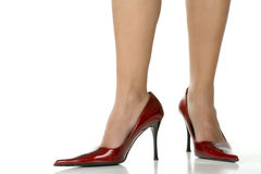 Beautiful legs with red shoes Stock Photography