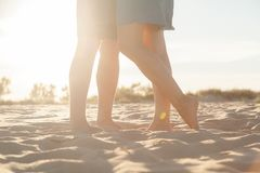 Beautiful legs on the sand. royalty free stock photo