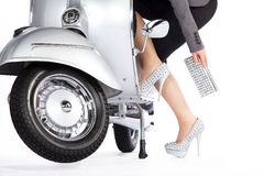 Beautiful legs with silver scooter Stock Images