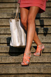Beautiful legs stepping down on stairway stock image