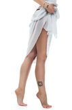 Beautiful legs with tattoo Royalty Free Stock Photo