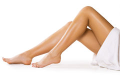 Beautiful legs on white. Beautiful legs. Isolated on white Royalty Free Stock Image