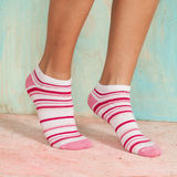 Beautiful legs woman with socks standing on tiptoe on the wooden floor Royalty Free Stock Image