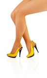 Beautiful legs of young girl in yellow shoes Royalty Free Stock Photography