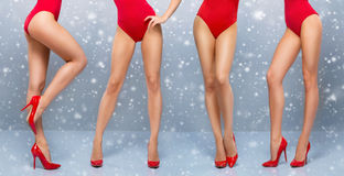 Beautiful legs of a young and sporty woman in a red swimsuit Royalty Free Stock Photography