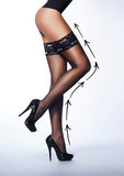 Beautiful legs of a young woman in nice stockings Stock Images