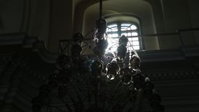 Beautiful lense flare at sun rays through churches window. HD stock footage