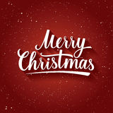Beautiful Lettering of Merry Christmas on red color background with snowflakes. Greeting Card. Stock Image