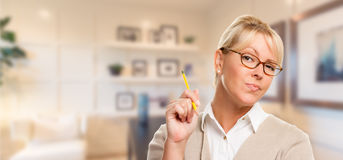 Beautiful Librarian, Student or Businesswoman with Pencil in Office Royalty Free Stock Photo