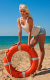 Beautiful lifeguard at sea Stock Image