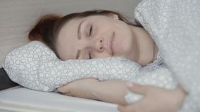 Beautiful lifestyle woman sleeping in bed at home