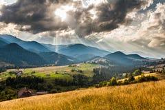 Beautiful light beam in morning, mountain. Beautiful light beam in morning with village on mountain valleys Royalty Free Stock Photo