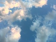 Beautiful light blue sky and white cloudy on the day. Color shade of nature background stock photo