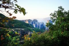 Beautiful light effect at dawn on the rock formations and monasteries of Meteora. Greece stock image