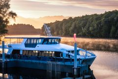 Sunrise Cruise to Doubtful Sound. Beautiful Light, fog and reflections early in the morning at Waiau River Bay, the starting point of the cruises for Doubtful Stock Photos